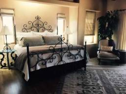 wrought iron guest bedroom